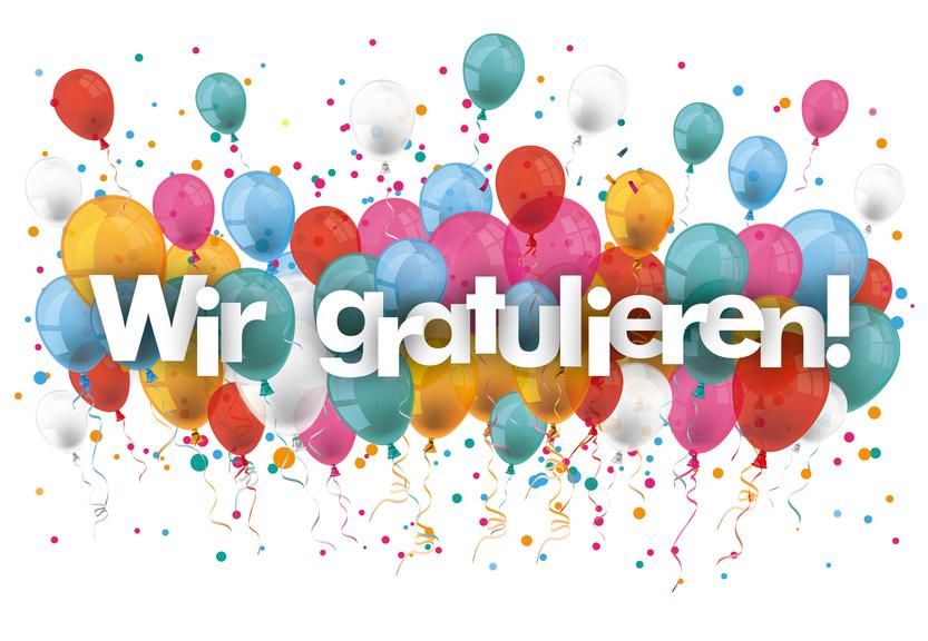 Ballone und Text «Wir gratulieren»